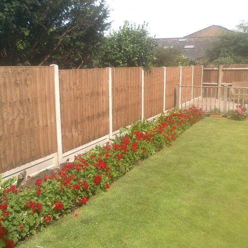Close board fence panels with concrete post and dished gravel boards Fence fitted in Bexleyheath